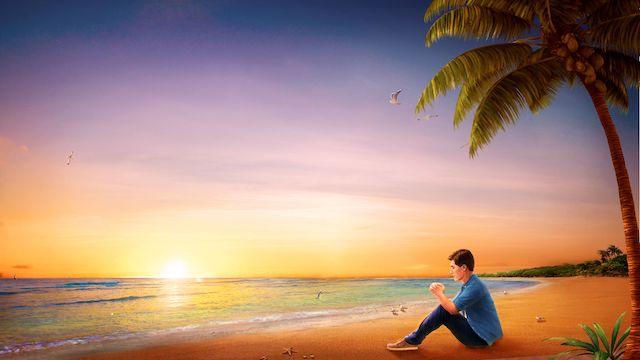 ein Mann, der am Meer sitzt und betet